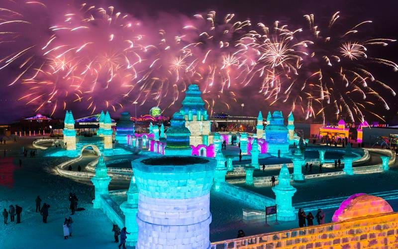 Fireworks display over the ice and snow sculptures of Harbin's annual festival