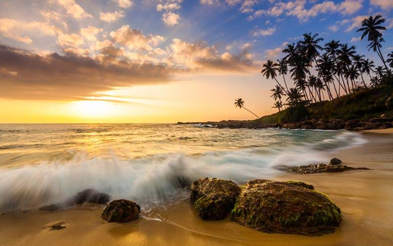 Tropical sandy beach at sunset in Sri Lanka - a great Christmas destination in Asia