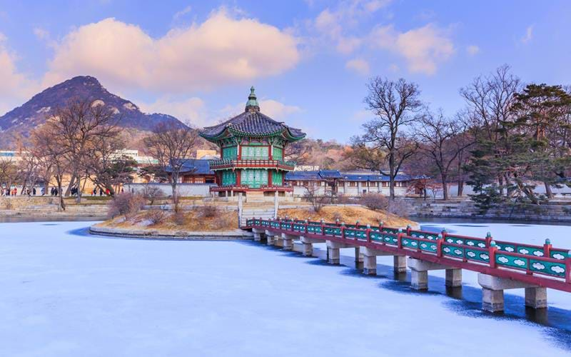 Gyeongbokgung Palace in winter cover by snow in Seoul, South Korea